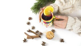Woman hands holding mug of mulled wine royalty free stock images