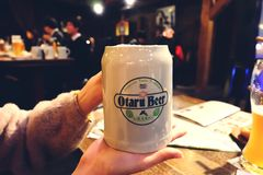TOKYO,JAPAN - ‎December‎ ‎30‎, ‎2017: woman hands holding mugs of japan beer in bar or restaurant at Japan royalty free stock photos