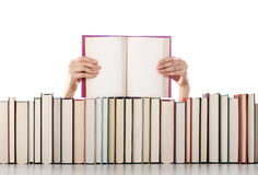 Woman hands holding an open book Royalty Free Stock Images