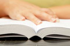 Woman hands holding open book Stock Photography