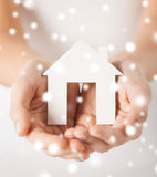 Woman hands holding paper house. Closeup piсture of woman hands holding paper house Stock Photography