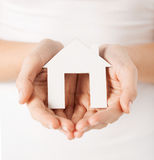 Woman hands holding paper house. Closeup picture of woman hands holding paper house Royalty Free Stock Photography