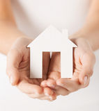 Woman hands holding paper house. Closeup pisture of woman hands holding paper house Royalty Free Stock Images