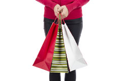 Woman hands holding paper shopping bags Royalty Free Stock Photo