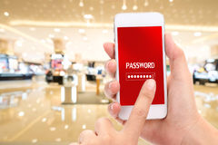 Woman hands holding phone with password on mobile screen and blu. R shopping mall background stock photo