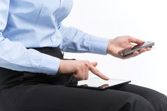 Woman hands holding and point on modern electronic digital. Royalty Free Stock Images