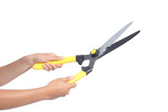 Woman hands holding a pruning shears Stock Photo