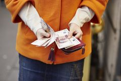 Woman hands holding purse with Russian roubles Stock Image