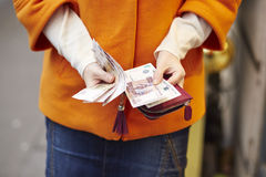 Woman hands holding purse with Russian roubles Stock Images