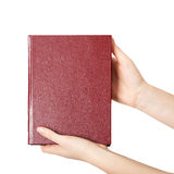 Woman hands holding red book Royalty Free Stock Photography