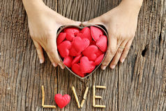 Woman hands holding red heart shaped Stock Images
