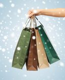 Woman hands holding shopping bags Royalty Free Stock Images