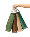 Woman hands holding shopping bags Royalty Free Stock Image