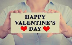 Woman hands holding sign happy valentine's day Royalty Free Stock Photography
