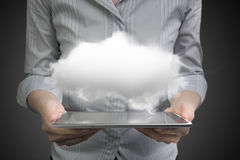 Woman hands holding smart tablet with white cloud Stock Photo