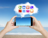Woman hands holding smartphone with app icons white cloud Royalty Free Stock Photos
