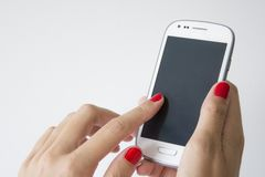Woman hands holding a Smartphone Stock Images