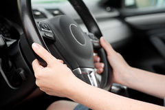 Woman hands holding steering wheel Stock Image
