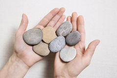 Woman hands holding stones. Concept for balance, combination, li Royalty Free Stock Image