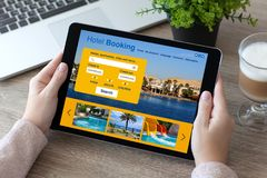 Woman hands holding tablet computer with app hotel booking scree Stock Image