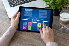 Woman hands holding tablet computer with app smart home room. Woman hands holding tablet computer with app smart home in room Stock Photo