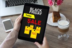 Woman hands holding tablet computer with sale black friday scree Royalty Free Stock Photo