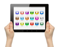 Woman hands holding tablet PC with icons Royalty Free Stock Photo