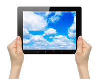 Woman hands holding tablet PC with sky Royalty Free Stock Image