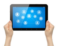 Woman hands holding tablet PC with social media illustration. On white background Stock Photo