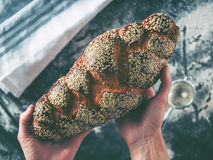 Woman hands holding tasty fresh bread, top view. Royalty Free Stock Image