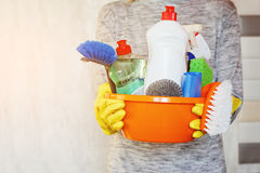 Woman hands holding tub with cleaning supplies. Royalty Free Stock Photos