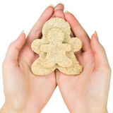 Woman hands holding two gingerbread men cookie Stock Photography