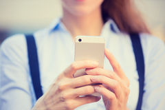 Woman hands holding, using smart, mobile phone. Closeup image woman hands holding, using smart, mobile phone isolated outside city background. New generation royalty free stock photos