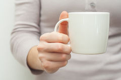 Woman hands holding white cup of tea or coffe Royalty Free Stock Photo
