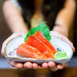 Woman hands holding white plate with Salmon sashimi Royalty Free Stock Photography