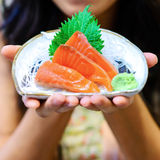 Woman hands holding white plate with Salmon sashimi Stock Photos