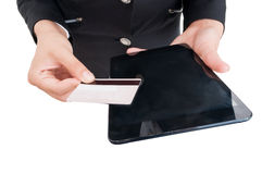 Woman hands holding wireless table and debit or credit card Royalty Free Stock Photo