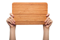 Woman hands holding wooden blank isolated on white background Royalty Free Stock Image