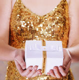 Woman hands holding wrapped gift box Royalty Free Stock Photos