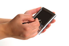 Woman Hands Holding and Writing on a PDA Device. Woman hands holding a personal digital assistant PDA and writing with a stylus pen Royalty Free Stock Photos