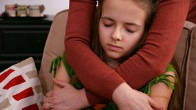 Woman hands hug worried sad girl offering support. Woman hands hug young worried and sad girl offering support and comfort in a hard time - closeup, static stock video
