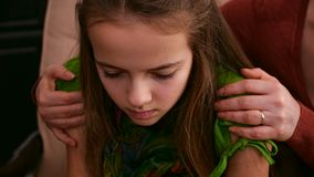 Woman hands hug worried and sad girl offering support. Woman hands hug young worried and sad girl offering support and comfort in a hard time - closeup, static stock footage