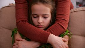 Woman hands hug young worried girl offering support. Woman hands hug young worried and sad girl offering support and comfort in a hard time - closeup, camera stock video