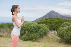Woman with hands joined standing on countryside landscape Royalty Free Stock Images