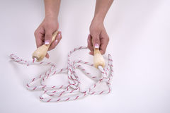 Woman hands with jump rope Royalty Free Stock Photos
