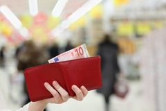 Woman hands keep purse with money in shop Royalty Free Stock Photo