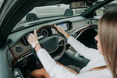 Woman hands keeping steering wheel in car Stock Photography