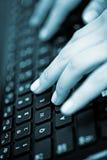 Woman hands on keyboard Stock Photo