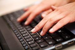 Woman hands on keyboard Stock Image