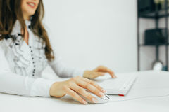Woman hands on keyboard Stock Photos